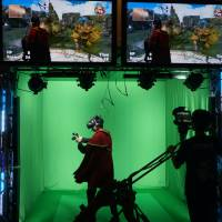Virtual world: A man battles monsters in a virtual reality game at the Tokyo Game Show on Sept. 15.   JASON COSKREY