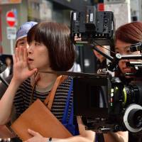 The personal touch: Yuki Tanada makes a call on the set of 'My Dad and Mr. Ito.'