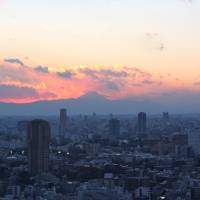 Sunset over Tokyo, seen from Tokyo Tower | KEVIN DOOLEY, VIA FLICKR / CC BY 2.0