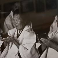 Old rituals: Okinawan priestesses called noro (above, in a print found in a Naha bookstore) have been an integral part of life on Kudaka Island. | STEPHEN MANSFIELD