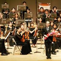 Take a bow: Takashi Niigaki basks in the applause after the premiere of his second symphony, 'Litany,' in Hiroshima on Aug. 15.