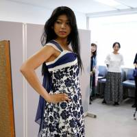Turning heads, changing minds: Miss World Japan 2016 Priyanka Yoshikawa tries on a dress earlier this month in Tokyo as she chooses a costume to wear in the Miss World competition. | REUTERS