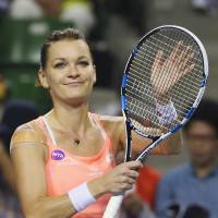 Agnieszka Radwanska acknowledges the crowd after defeating Monica Puig in their quarterfinal match at the Pan Pacific Open at Ariake Colosseum on Friday. Radwanska won 6-2, 6-3. | AP
