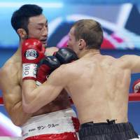 Russian champion Troyanovsky overwhelms Obara, retains light welterweight title
