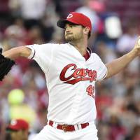 Pitcher Kris Johnson joined the Hiroshima Carp last year and has settled in well with the team. | KYODO