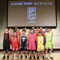 Players from each of the B. League's 18 first-division squads represent their teams during a Sept. 12 preseason media event in Tokyo. | KAZ NAGATSUKA