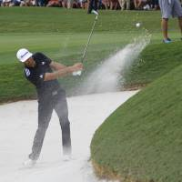 Johnson tied for lead in Tour Championship