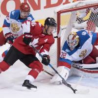Canada beats Russia to reach final round