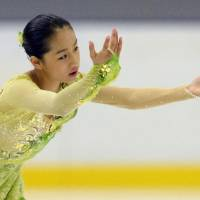 Mako Yamashita performs to 'Nocturne' during the women's short program at the Yokohama Junior Grand Prix on Friday. Yamashita is in second place with 64.86 points. | KYODO