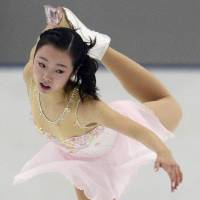 Marin Honda skates in the short program on Friday at the Yokohama Junior Grand Prix. Honda, the reigning world junior champion, is in fifth place with 55.47 points. | KYODO