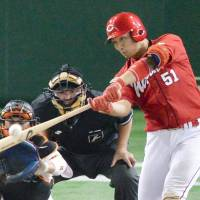 The Carp's Seiya Suzuki slugs a leadoff home run in the fourth inning against the Giants at Tokyo Dome on Saturday. Hiroshima defeated Yomiuri 6-4 to clinch the Central League pennant. | KYODO