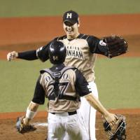 Shohei Otani tossed a one-hitter and struck out 15 Wednesday night as the Hokkaido Nippon Ham Fighters beat the Saitama Seibu Lions 1-0 to clinch the Pacific League pennant. | KYODO