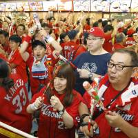 Hiroshima Carp fans provide enthusiastic support for their team on Saturday at Tokyo Dome. | KYODO