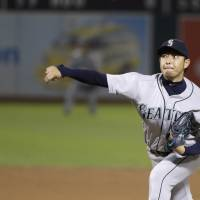 Iwakuma matches career high with 15th victory