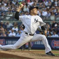 Tanaka wins 13th with gem against Rays