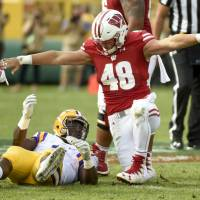 Wisconsin rallies for upset of No. 5 LSU at Lambeau Field