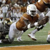 Longhorns edge Irish in double-OT thriller