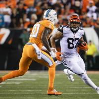 Green shines as Bengals smother Dolphins