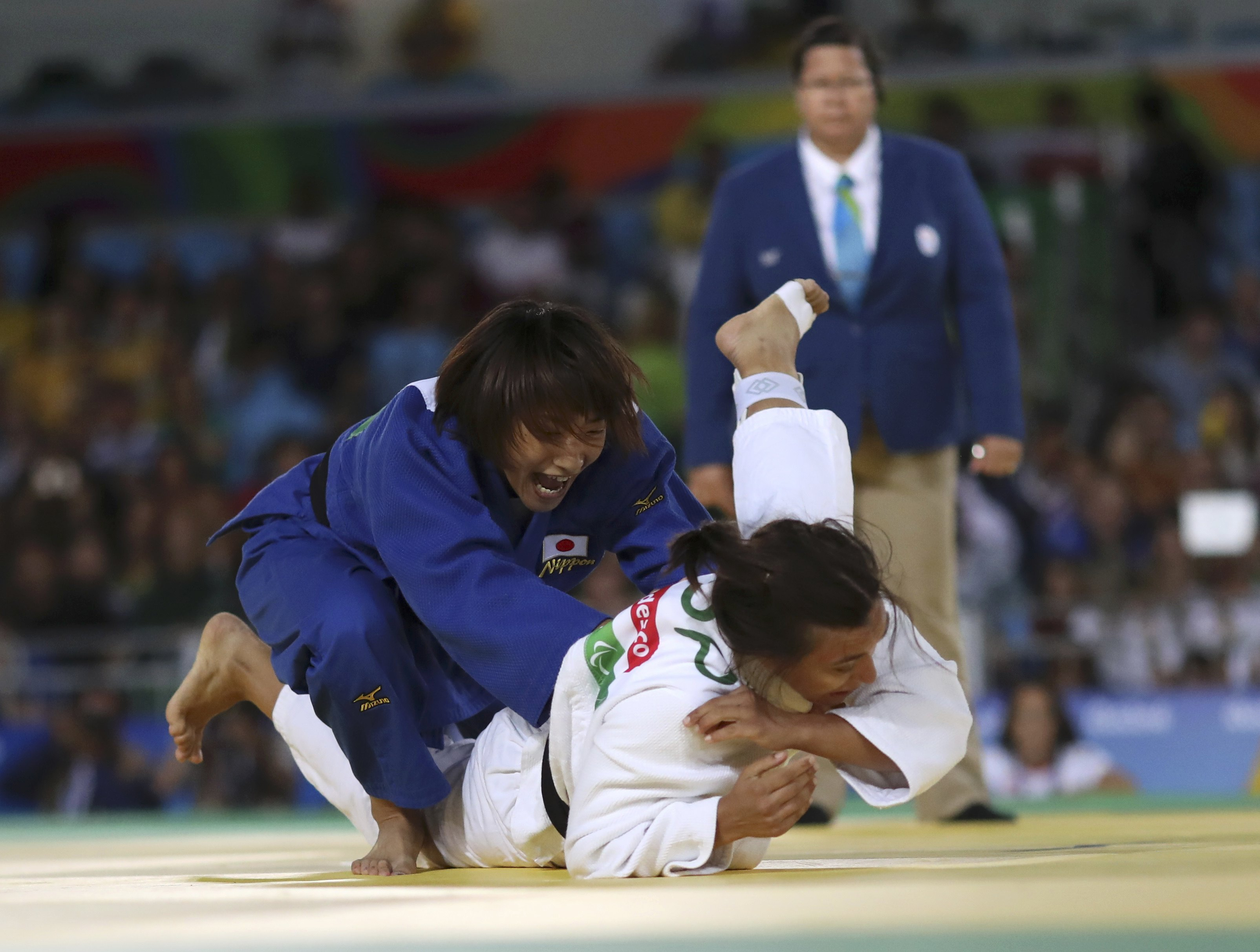 Junko Hirose (left) competes against Spain's Maria Merenciano Herrero during their bronze medal match at the Paralympics on Friday. | REUTERS