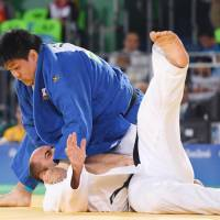 Japan's Kento Masaki throws Iran's Hamzeh Nadri in the bronze-medal match in the men's over-100-kg judo competition at the Rio Paralympics on Saturday. | KYODO