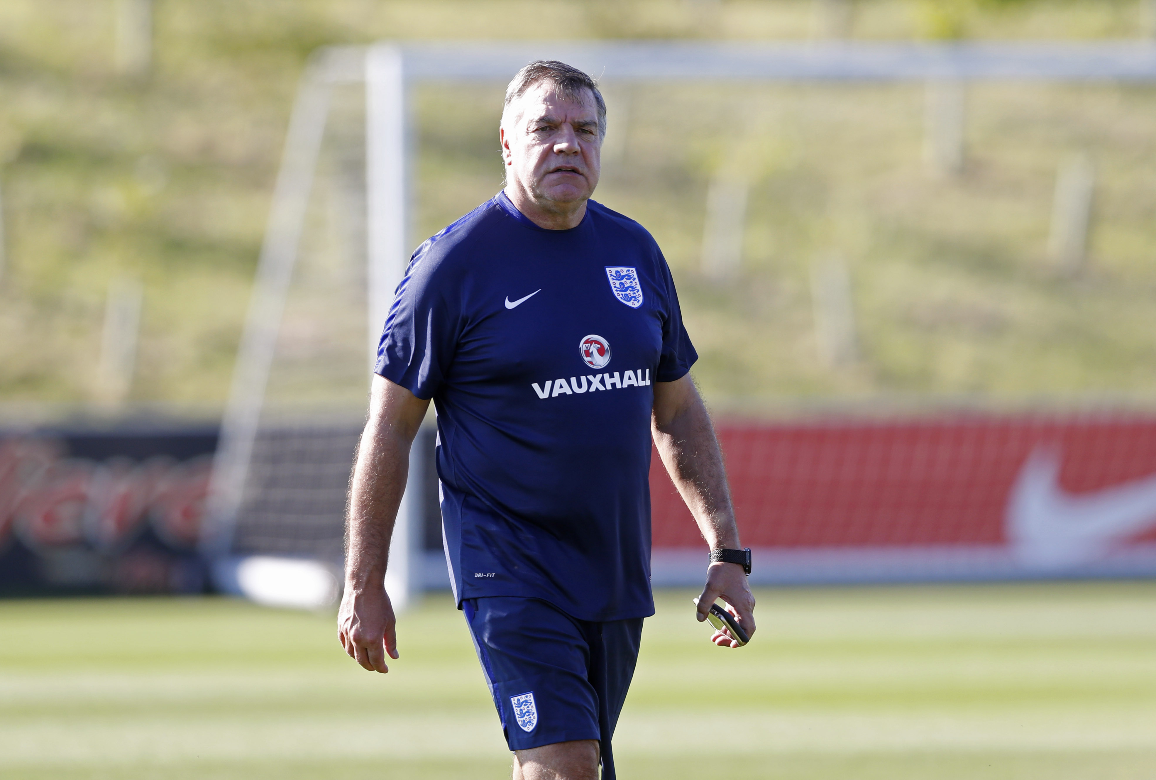 England manager Sam Allardyce watches a training session earlier this week. England faces host Slovakia on Sunday. | REUTERS