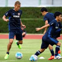 Japan's Keisuke Honda practices with his teammates on Saturday in Bangkok. | REUTERS