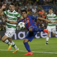 Barcelona thrashes Celtic in Champions League opener