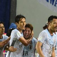 Japan's Asano Takuma (third from left) celebrates with his teammates after scoring a goal during the 2018 World Cup football qualifying match between Thailand and Japan in Bangkok on Tuesday. | AFP-JIJI
