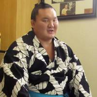 Yokozuna Hakuho explains his reasons for withdrawing from the forthcoming Autumn Grand Sumo Tournament on Thursday.   KYODO