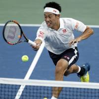 Nishikori tops Mahut to reach fourth round