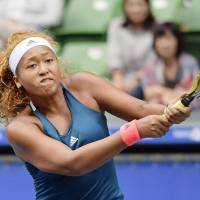 Naomi Osaka plays a shot against Dominika Cibulkova in the Pan Pacific Open second round on Wednesday at Ariake Colosseum. Osaka earned a 6-2, 6-1 win. | AP