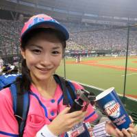 Retiring beer girl Misato Orikasa prepares to draw one of the last Asahi Super Drys of her four-year career selling brewskis at Seibu Lions games. | WAYNE GRACZYK
