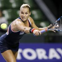 Dominika Cibulkova of Slovakia hits a return against the Czech Republic's Lucie Safarova in the first round of the Pan Pacific Open on Tuesday at Ariake Colosseum. | AP