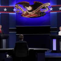 Republican U.S. presidential nominee Donald Trump and Democratic nominee Hillary Clinton begin their third and final 2016 presidential campaign debate at UNLV in Las Vegas, Nevada, on Wednesday. | REUTERS