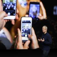 Apple quarterly profit off 19% as iPhone sales slip but Cook upbeat