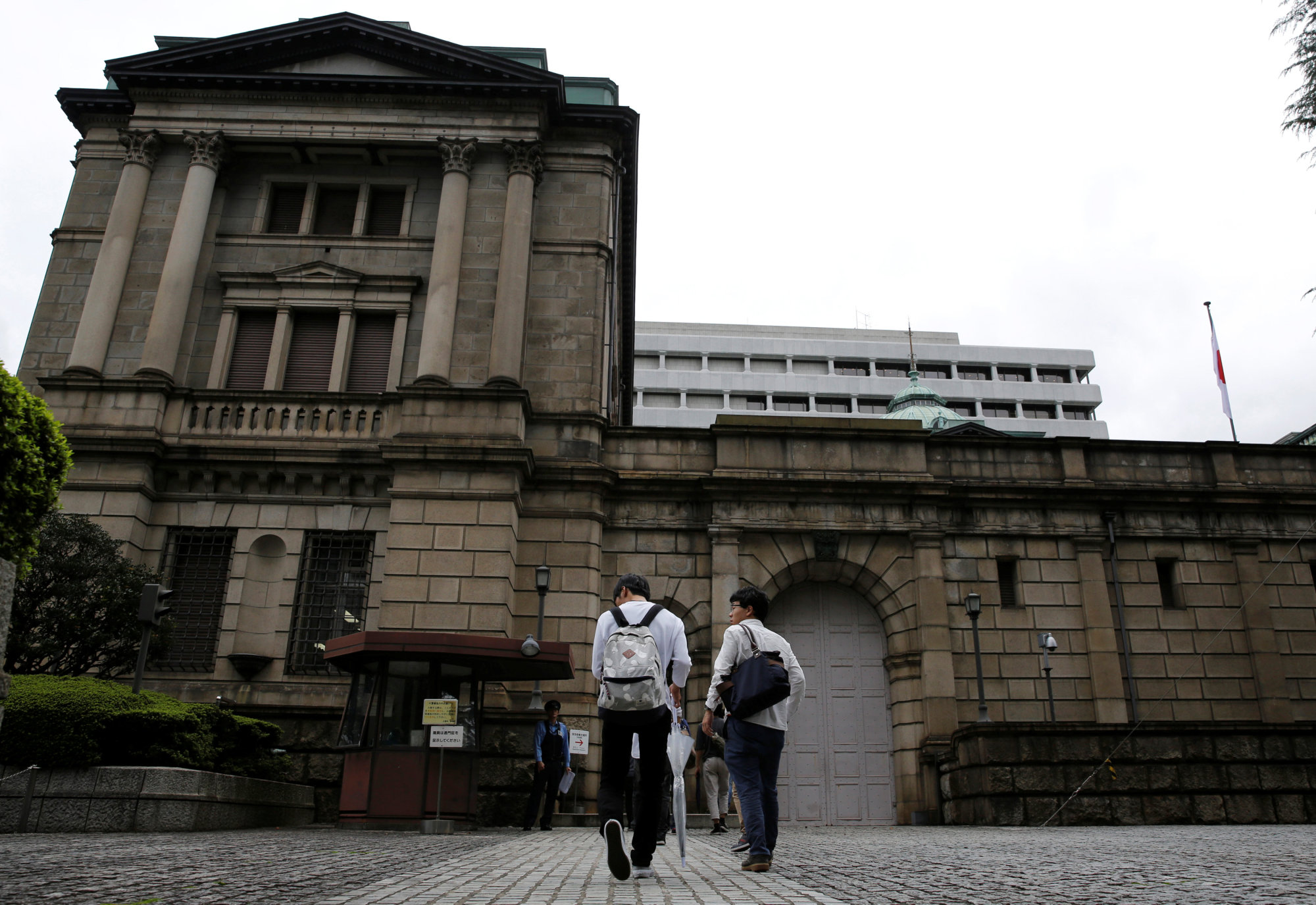 The Bank of Japan's recent shift of monetary policy has left Japanese firms unimpressed, a poll shows. | REUTERS