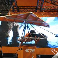 A model demonstrates virtual reality hang-gliding at TE Connectivity's booth at CEATEC, which kicked off Tuesday at Makuhari Messe in Chiba. | KAZUAKI NAGATA