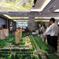 Chinese cities move to restrict property purchases to cool soaring prices