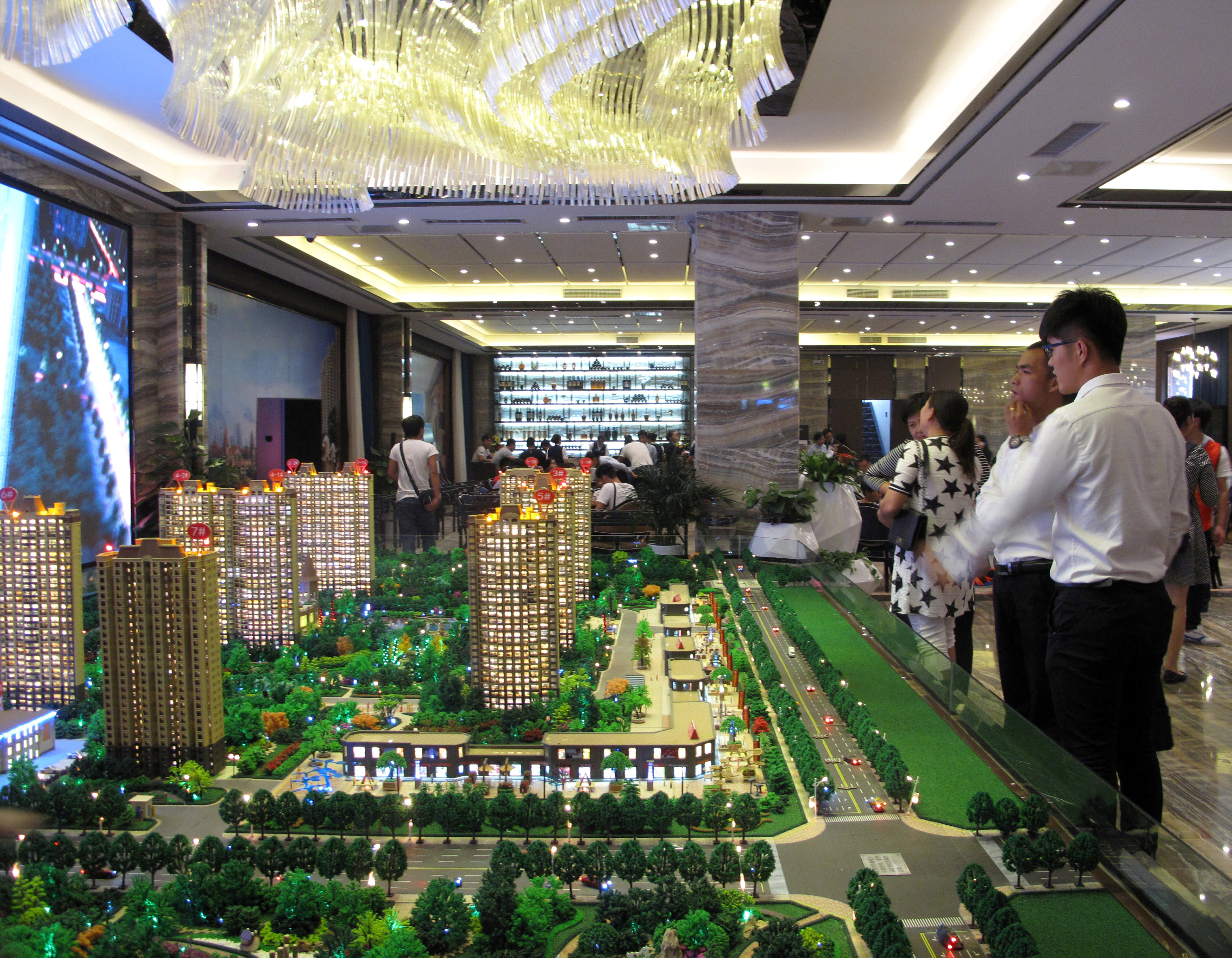 Models of residential buildings are seen at a sales center in Zhengzhou, in China's Henan province, on Sept. 23. | REUTERS