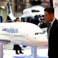 A visitor looks at Airbus's A380 flight model during the Japan Aerospace 2016 air show in Tokyo on Wednesday. | REUTERS