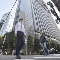 Dentsu Inc. is lowering its overtime limit after the labor ministry inspected the firm and its five subsidiaries, including Dentsu East Japan Inc. in Tokyo's Minato Ward, in the wake of a staff member's suicide. | KYODO