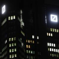 Germany Inc. execs stand with embattled Deutsche Bank