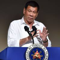 Only economic deals with China, Duterte assures Japanese investors