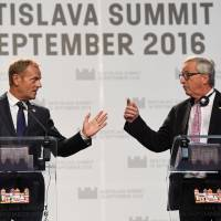 European Council President Donald Tusk (left) and European Commission President Jean Claude Juncker hold a news conference at the end of an EU summit in Bratislava in September. | REUTERS / KYODO
