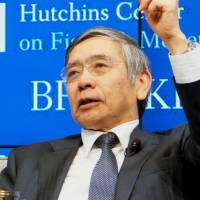 Bank of Japan Gov. Haruhiko Kuroda speaks at the Brookings Institution think tank in Washington on Saturday. | KYODO