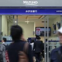 Mizuho Financial Group Inc. is seeking to take a larger piece of Japan's brokerage business. | BLOOMBERG