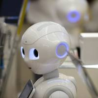 SoftBank's Pepper, which debuted last year, is struggling to find a sales niche because many clients still find the robot impractical. | BLOOMBERG