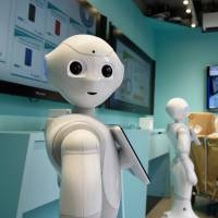 A customer visits the Pepper-Packed Mobile Shop operated by SoftBank in Tokyo March 24.   BLOOMBERG