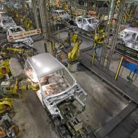 Robots work on the bodywork of a Nissan Qashqai automobile at the production plant in Sunderland, Britain, in 2010. | BLOOMBERG