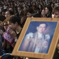 Tourism venues, red-light areas told to turn down volume as Thailand enters period of mourning for late king